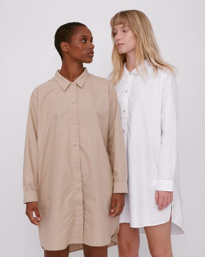 two women wearing shirts