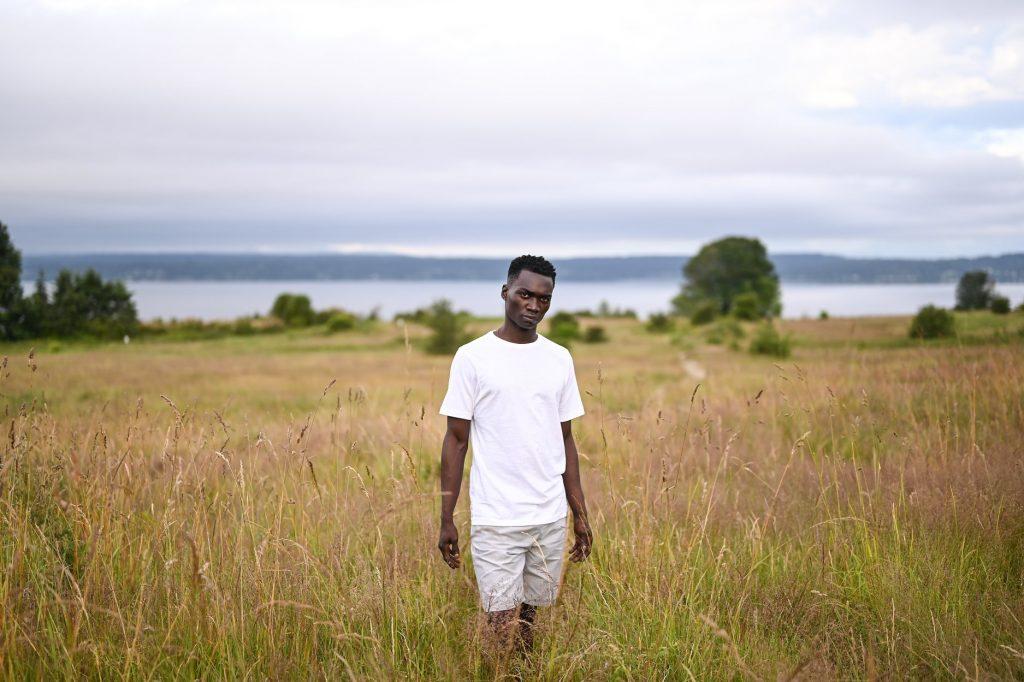 man in grassy field