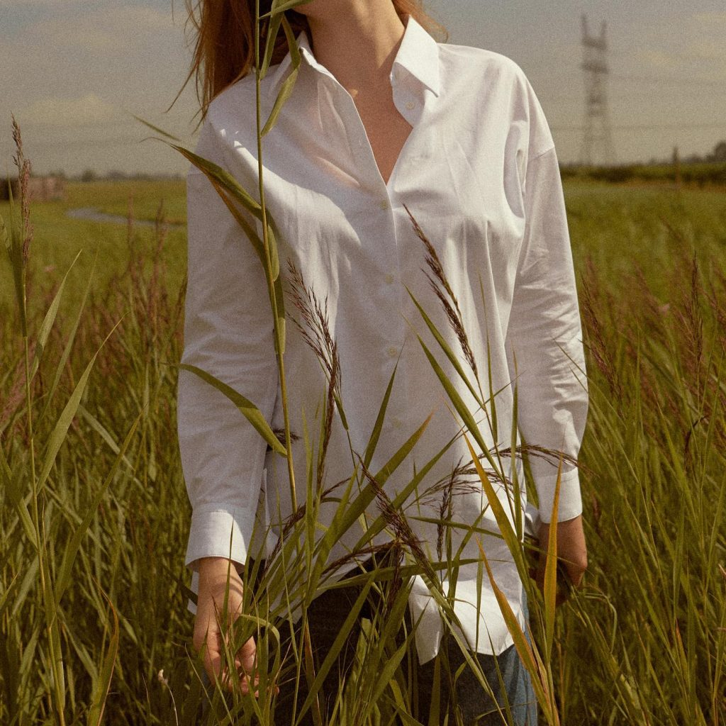 woman with white shirt in field