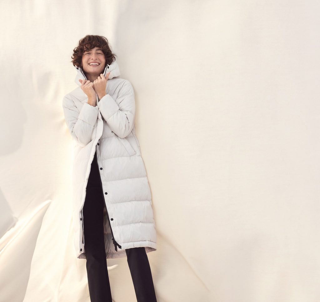 laughing woman in white coat