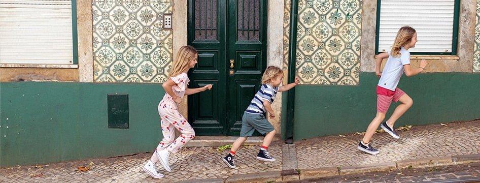 kids running up sidewalk