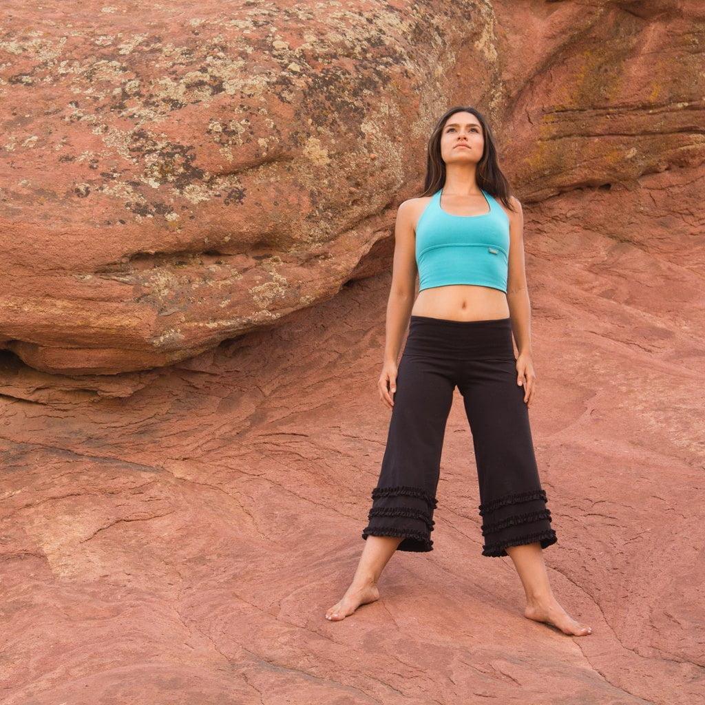 woman in yoga wear on rocky outcrop