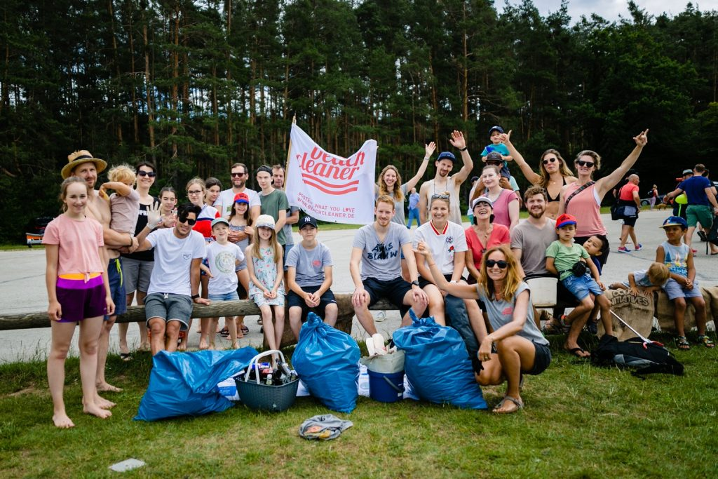 group celebrating beach cleanup