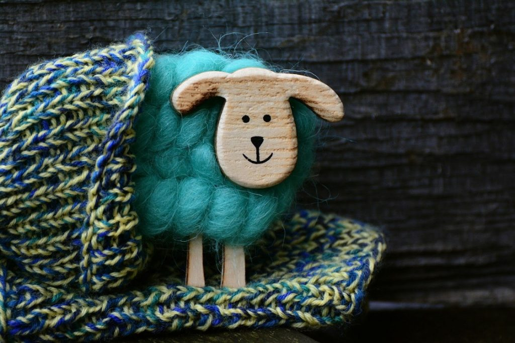 hand knitted sheep doll