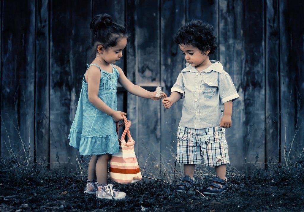 Girl giving boy a flower