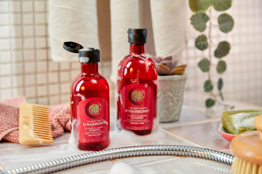 shampoo bottles in strawberry red on bench