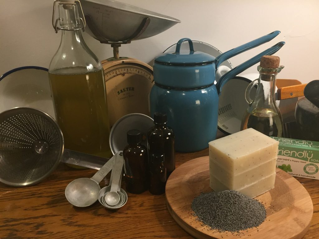 Vintage kitchenware and shampoo bars stacked up neatly on cheese board