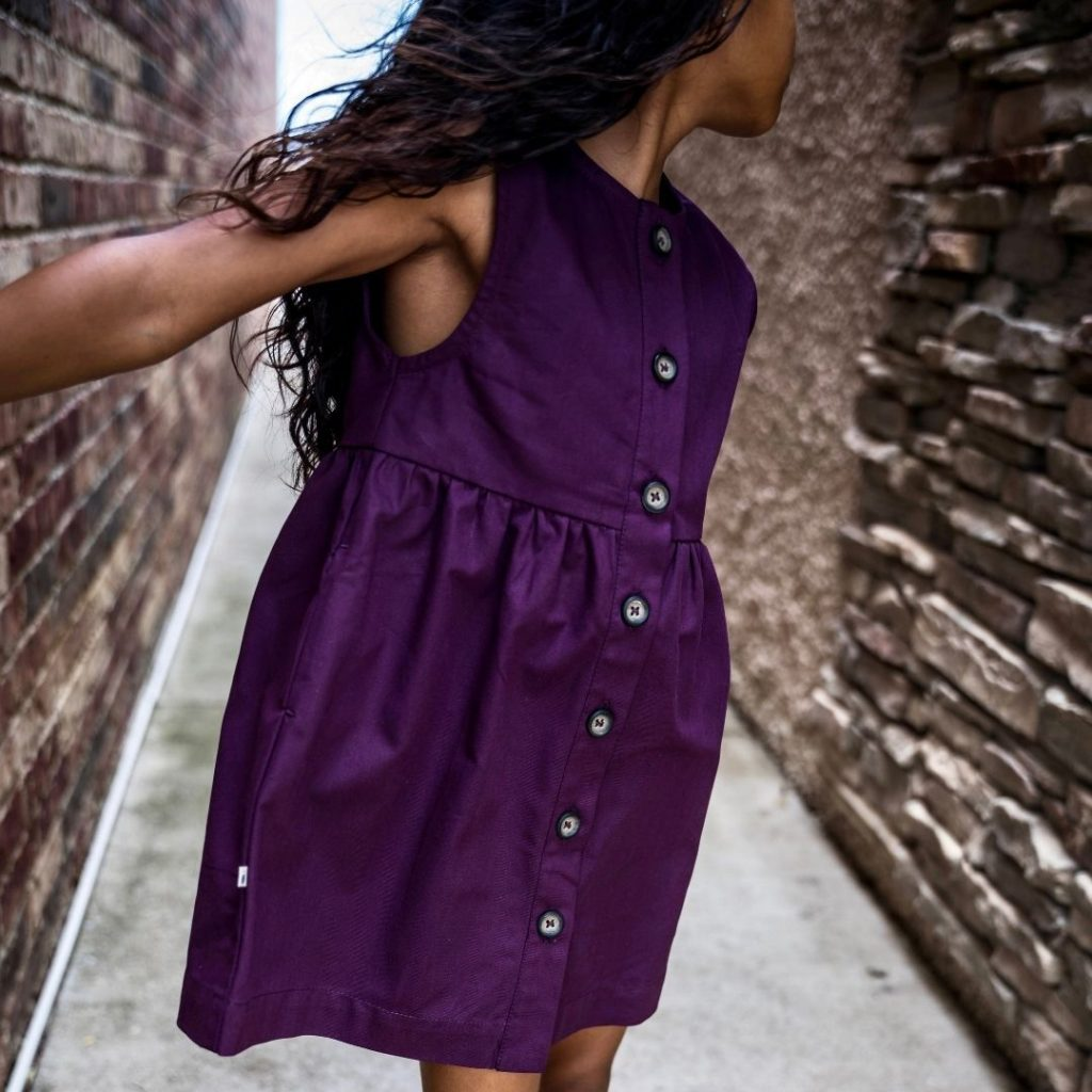 sustainable kids clothing: berry dress in purple