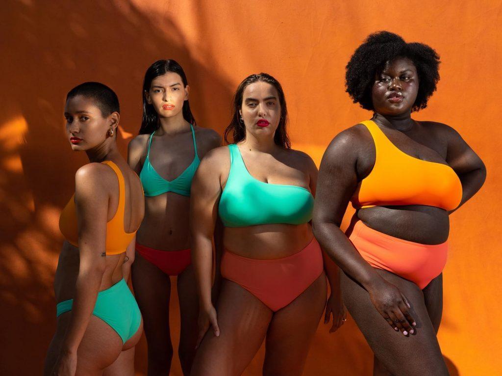 4 women in different sized bikinis