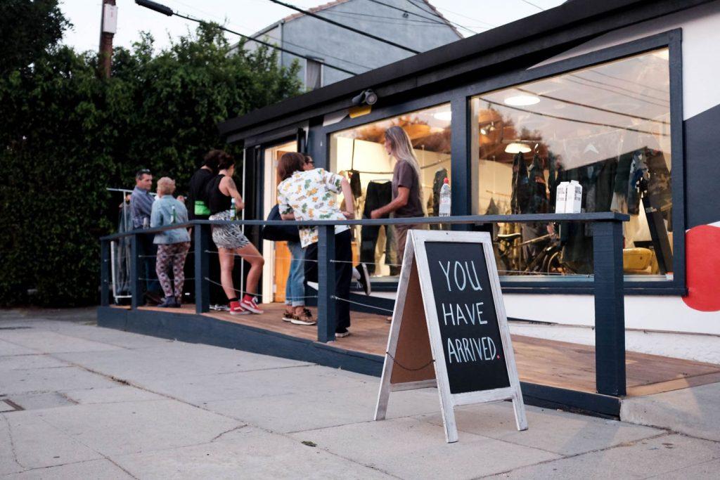 people outside jean repair shop