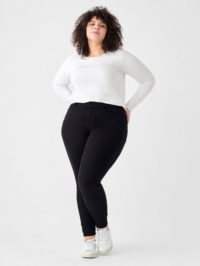 plus-sized woman in jeans and white tshirt