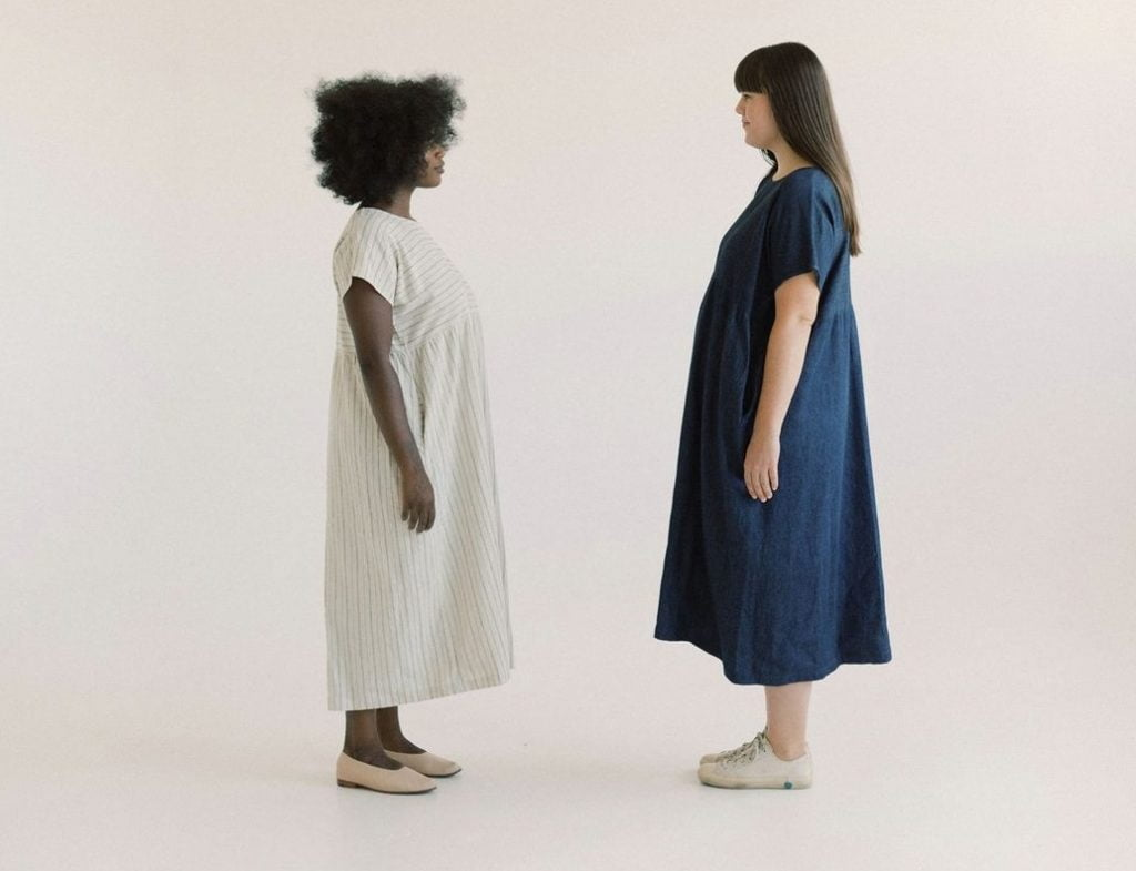 two size inclusive women facing one another
