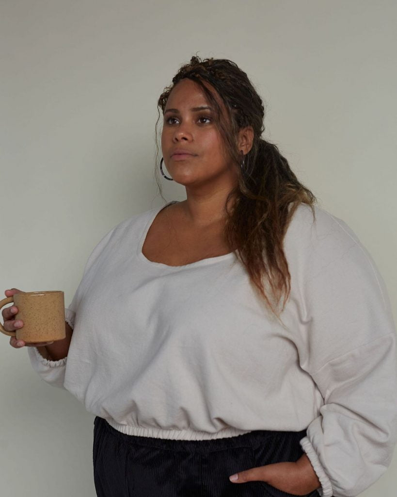 woman in beautiful clothing holding cup