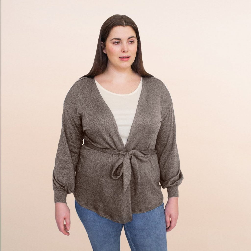 woman in plus sized cardigan and jeans