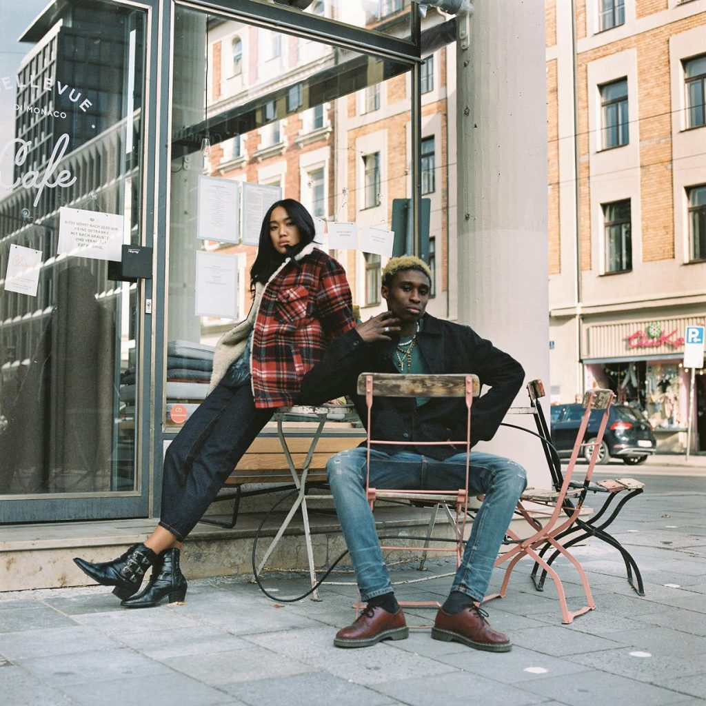 man and woman outside café in jeans