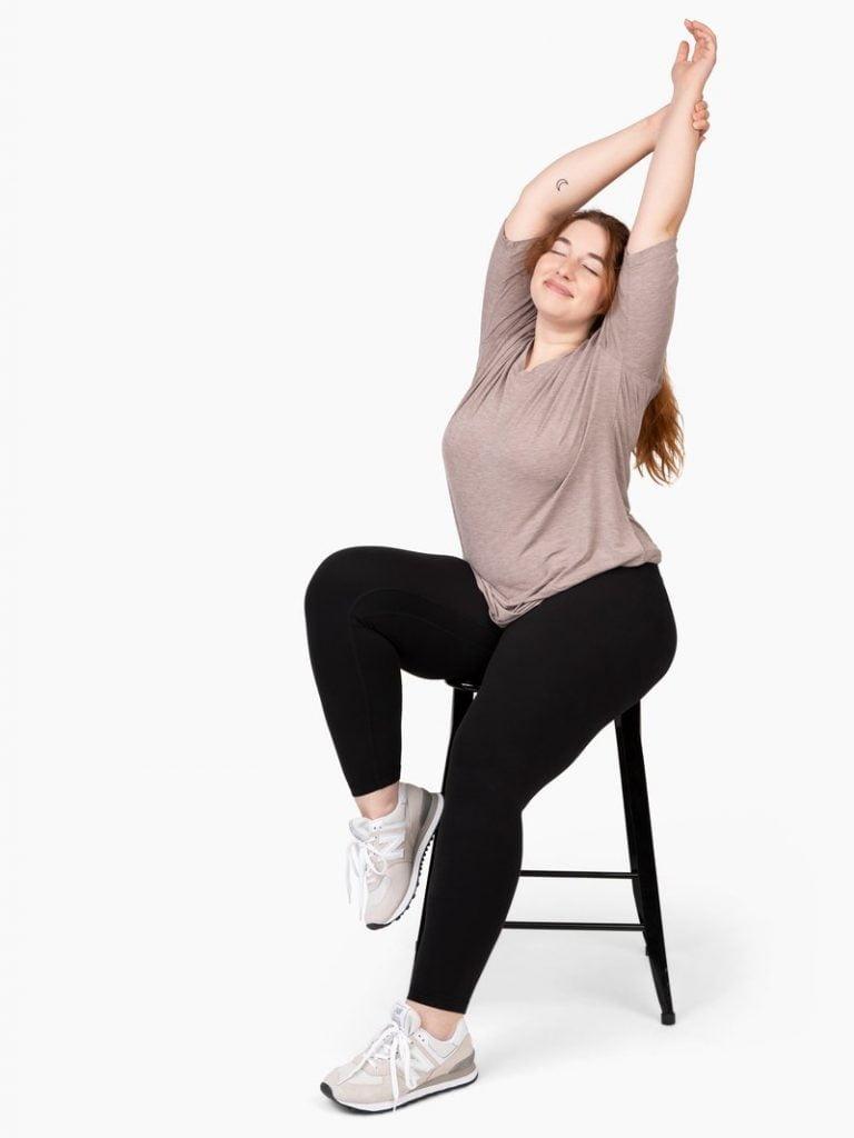 woman stretching, sitting on bar stool