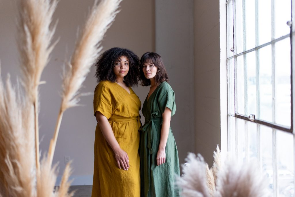 two women in linen dresses