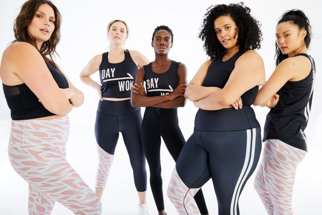 5 girls in different sizes of black activewear