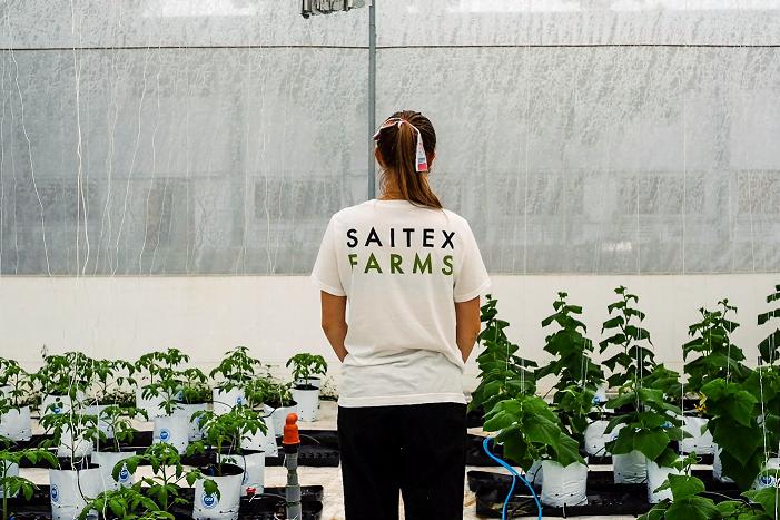 woman in saitex farms tshirt