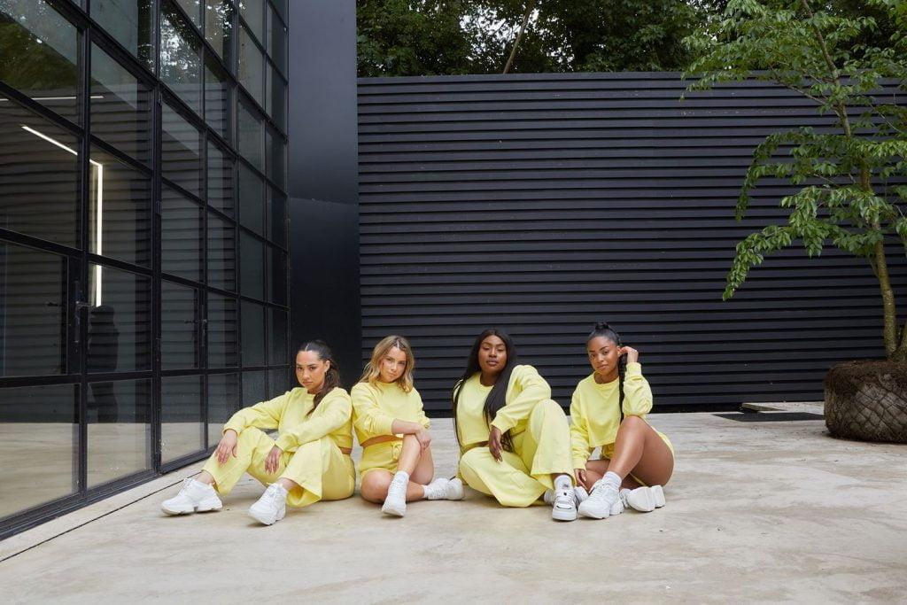 4 girls in yellow activewear