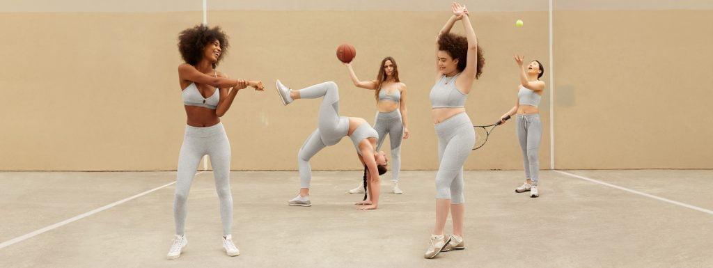 Women in grey activewear in indoor court