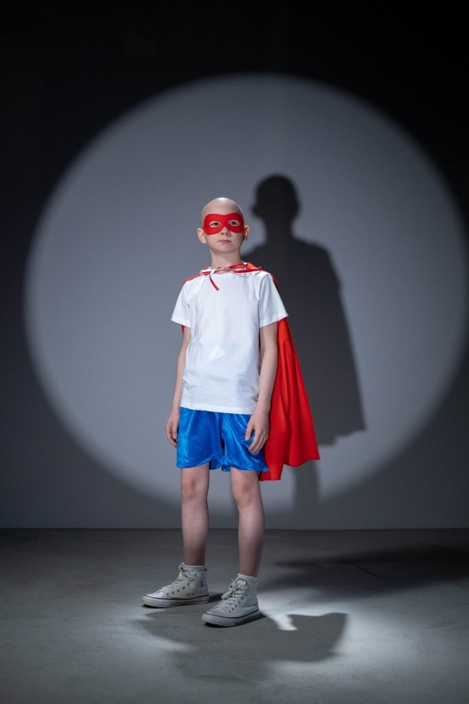 boy in superhero outfit