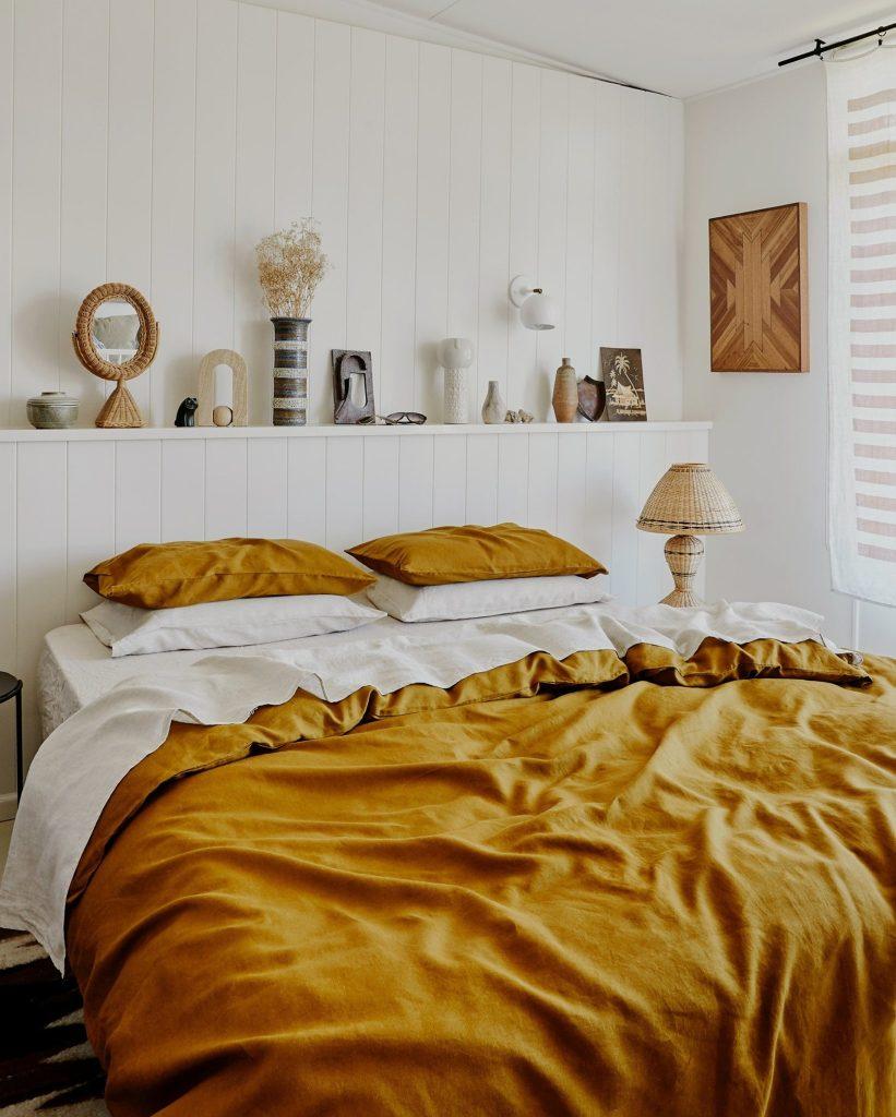 bed with orange duvet