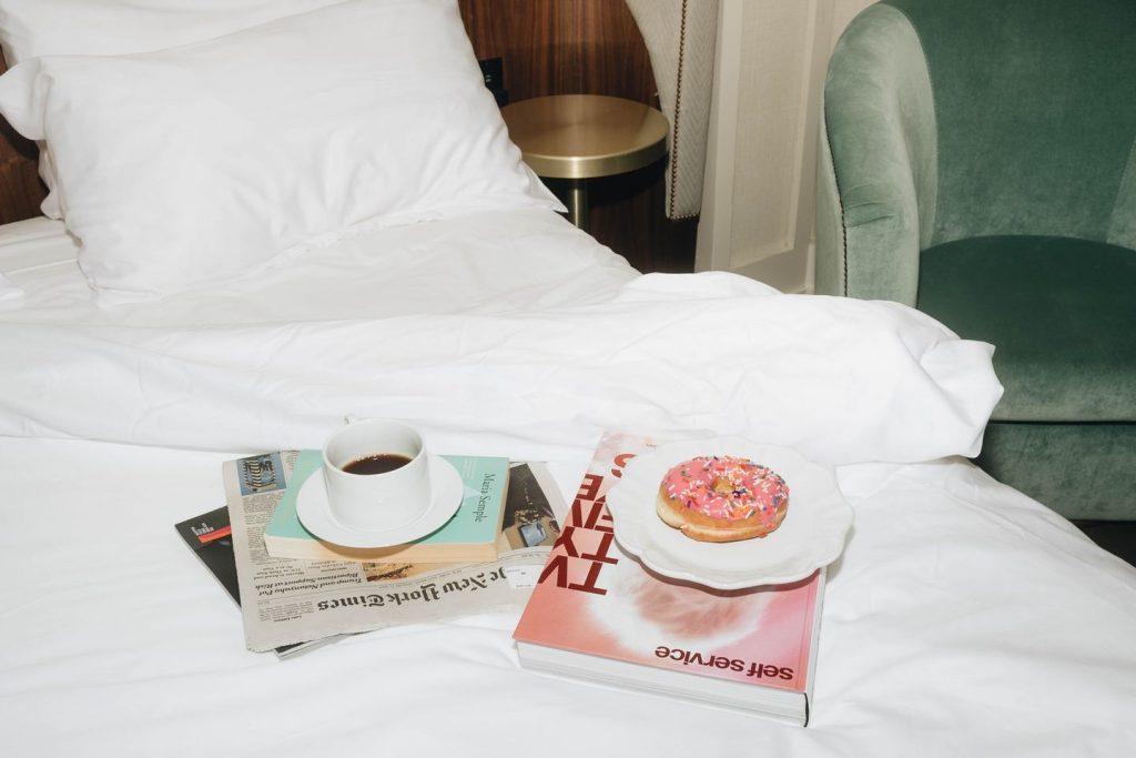 coffee and doughnut on bed