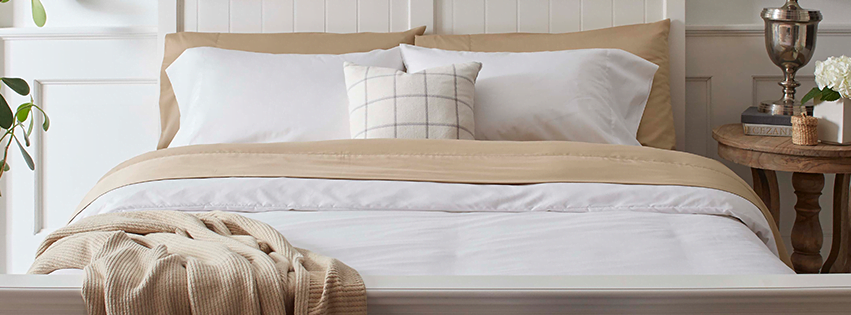 plain sustainable sheets on bed