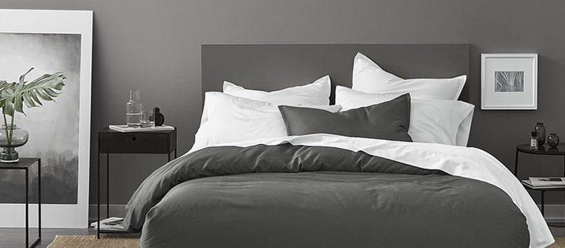 Gryphon sustainable bedding set in grey room