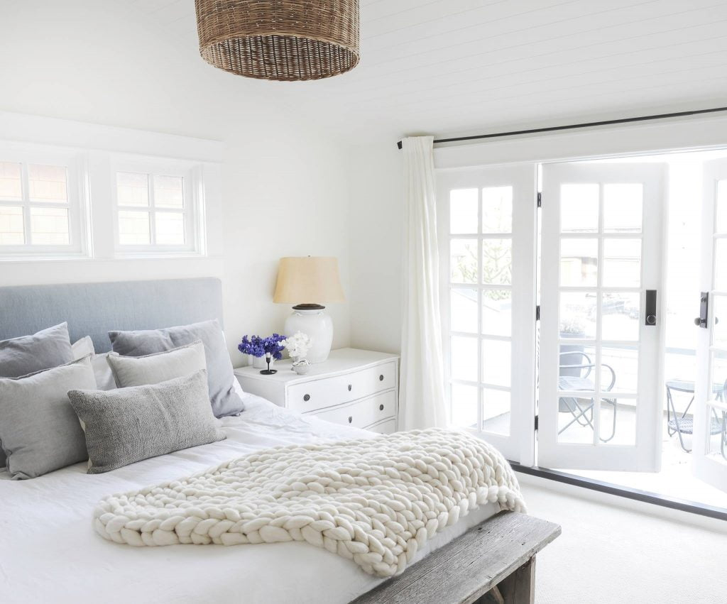 Clean white bedroom with flowers