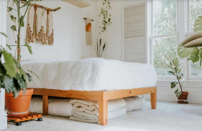 sustainable sheets folded and placed under bed