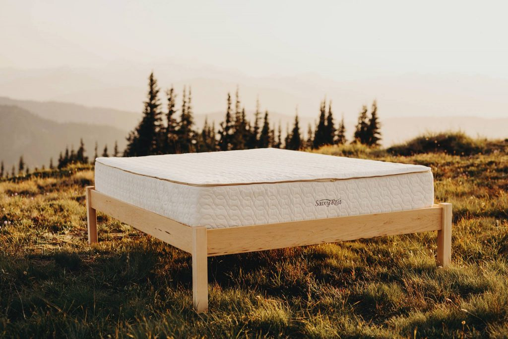 bed frame and mattress out on hilltop