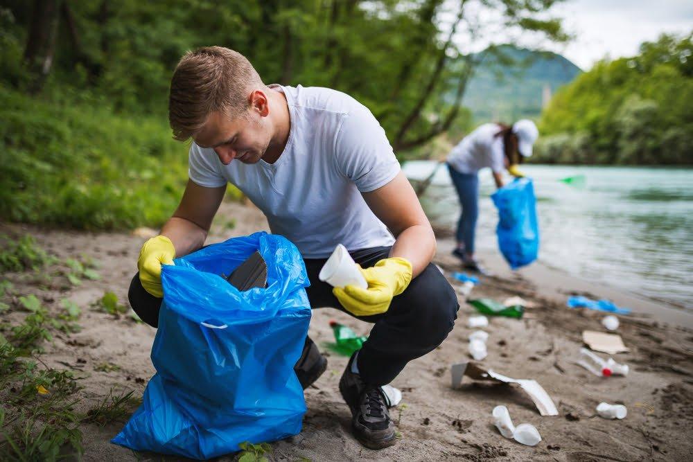 man picking up waste