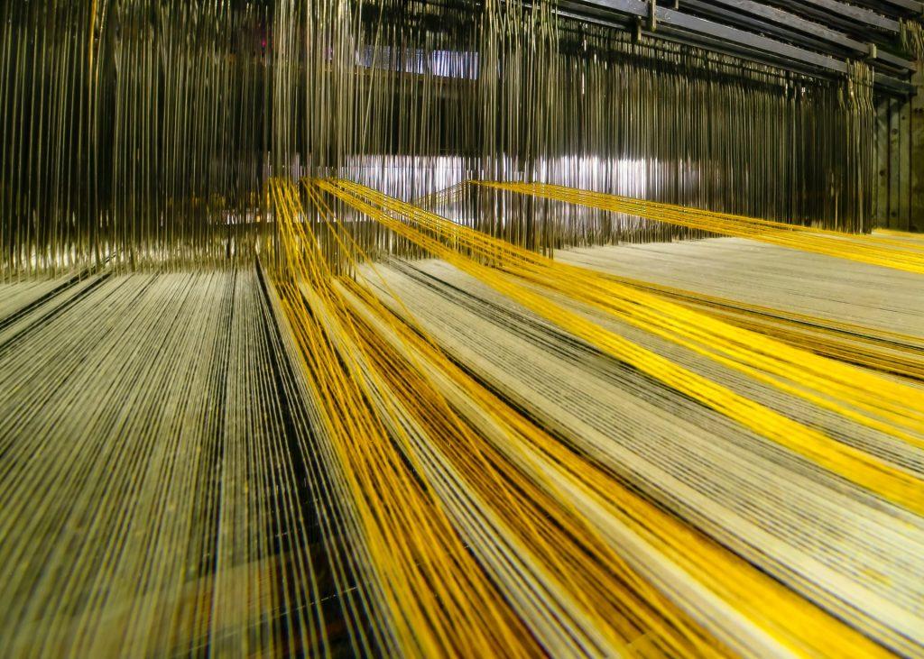 threads inside giant loom machine