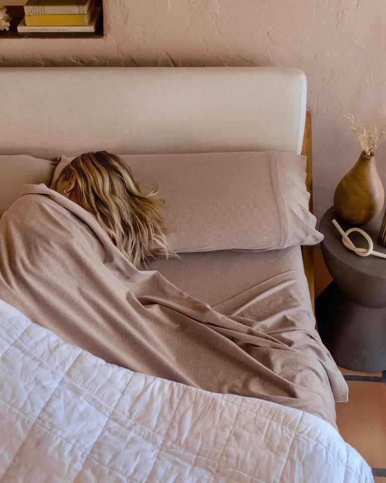 woman sleeping in organic sheets