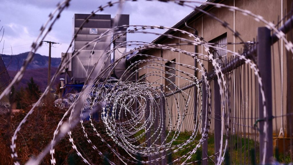 a prison barbed wire fence